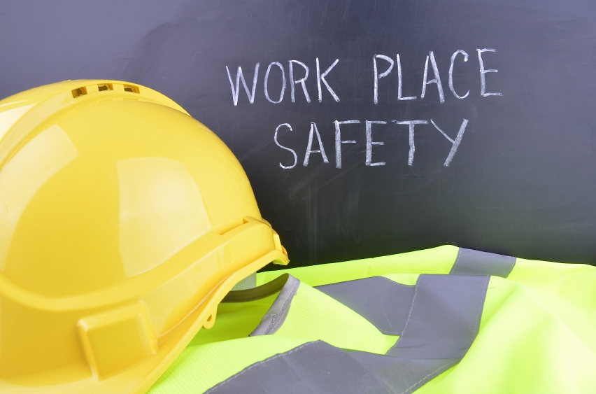 Hard helmet and safety jacket ensuring construction work place safety
