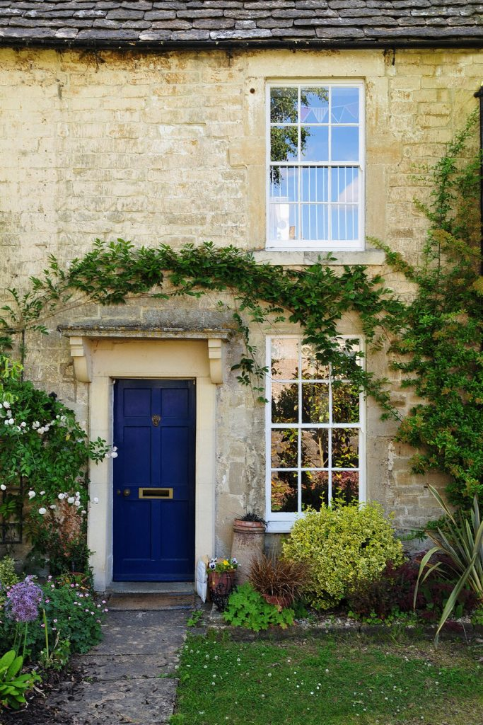 Exterior and Garden of an Old English Stone Cottage