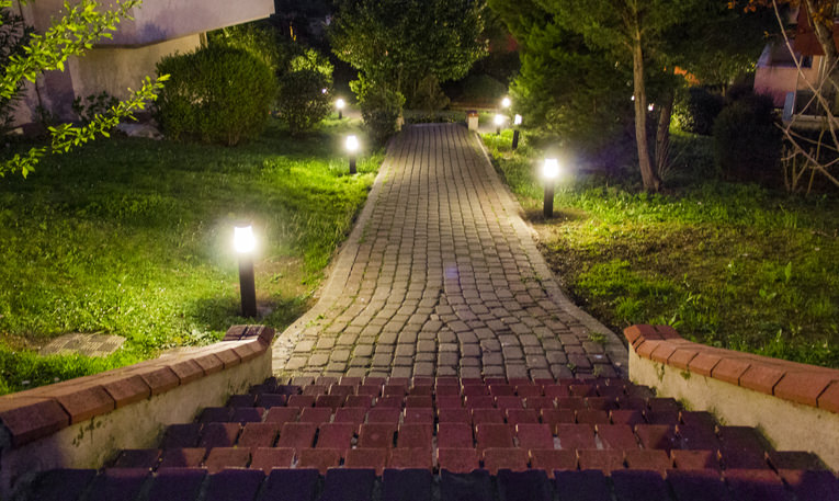House Path Lit By Lights